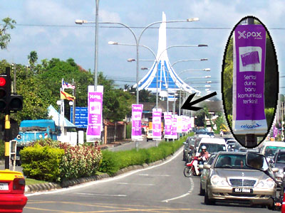 Celcom, Digi and Maxis banners are everywhere in the streets of Kuching